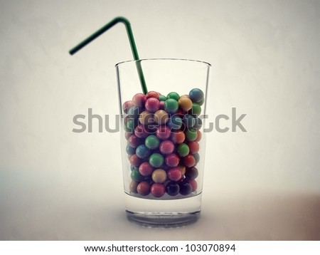 gumballs in a glass isolated on white background - stock photo
