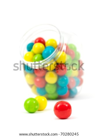 Gumballs in a jar isolated against a white background