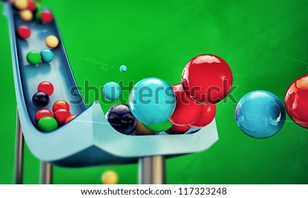 gumballs sliding down isolated on green background - stock photo