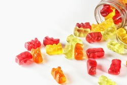 Gummies on an isolated background in a glass container