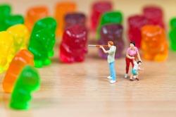 Gummy bear invasion. Junk food concept