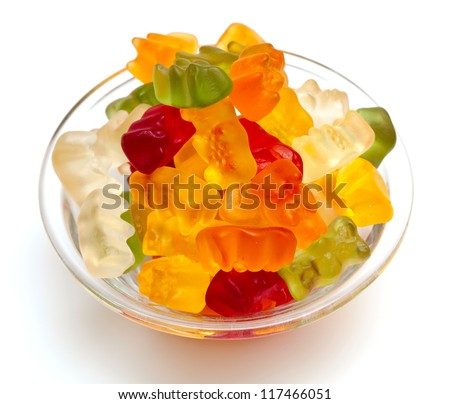 gummy bears candies in a bowl isolated on white background
