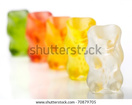 Gummy bears candy in a row on a white background... Shallow DOF.