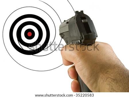 Gun aimed at a bullseye - stock photo