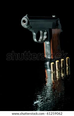 gun and four bullet