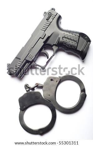 gun and handcuffs isolated - stock photo