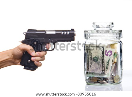 Gun and money on the white background
