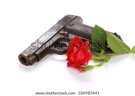 Gun and rose on white background