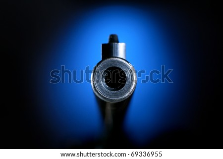 Gun barrel on blue pointing straight on