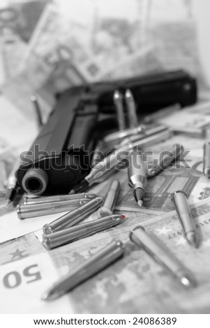 gun bullets and money showing a dangerous side to life