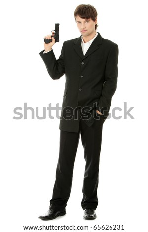 Gun control concept - businessman with handgun, isolated on white