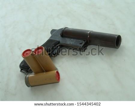 Gun for launching flares. Rocket launcher.