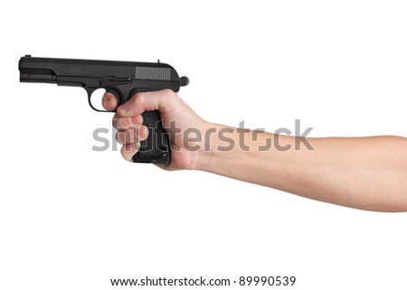 Gun in his outstretched hand of a man on  white background