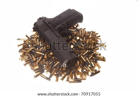 gun on pile of bullets