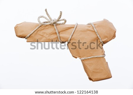 gun packed with paper and twine for shipping