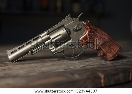 Stock Photo Gun revolver on the table.