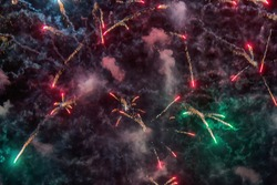 Gun salute sow as royal salute explodes. Fireworks multi-colored glare. Colorful exploding fireworks in sky. Festive and triumphant scenery
