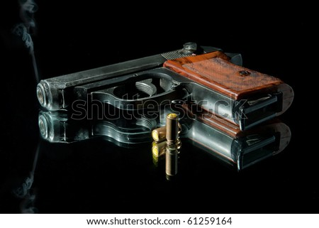 gun with bullet on a black
