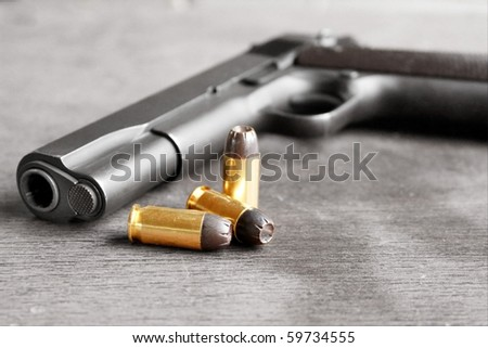 Gun with bullets. Gun is desaturated for stronger effect on bullets