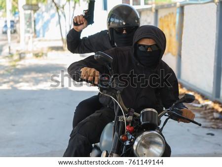 Gunman and motorcycle rider. #761149144