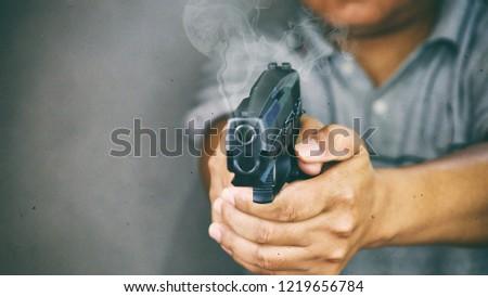 Gunman killed shooting his target.
