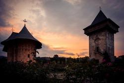 GURA HUMORULUI, ROMANIA - August 14 2019: The orthodox monastery Humor at sunset. UNESCO World Heritage Site. Suceava county, Romania.