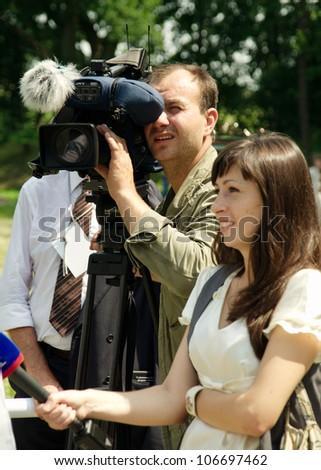 GURYEVSK, KALININGRADSKAYA OBLAST, RUSSIA - JUNE 30: cameraman journalist in celebration of 750 anniversary of Guryevsk (Neuhausen O.P.) on June 30, 2012 in Guryevsk, Kaliningradskaya oblast, Russia