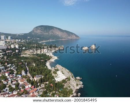 GURZUF, CRIMEA - Aerial Panoramic view on Gurzuf bay with Bear mountain Ayu-Dag and rocks Adalary, Artek - oldest children vacation camp. Yalta region, the South coast of Crimea peninsula Stockfoto ©