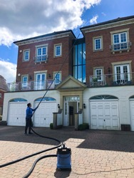 Gutter Clearing/Cleaning Using a Gutter Vacuum GutterVac on a Building Using Carbon Fibre Poles on a House in England