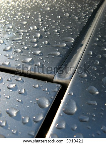 gutterpipe on car roof with rain drops