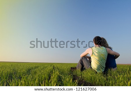 guy and girl in the field
