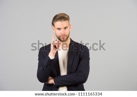 Guy bearded attractive shows warning gesture. Attention concept. Man with beard unshaven guy looks handsome well groomed formal wear. Businessman bearded strict calm warning face, grey background.