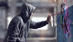 Guy drawing with spray . Mixed media