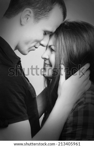 guy embracing girl look at each other #213405961