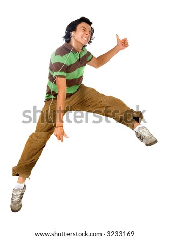 guy enjoying his music jumping in the air isolated over a white background