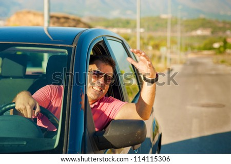 Guy gesturing out of the window of his car