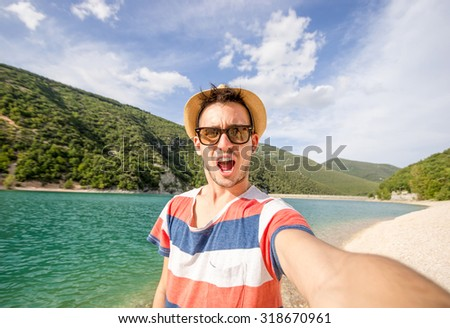 Guy gets a selfie during his vacation at sea - people, holiday, nature and lifestyle concept