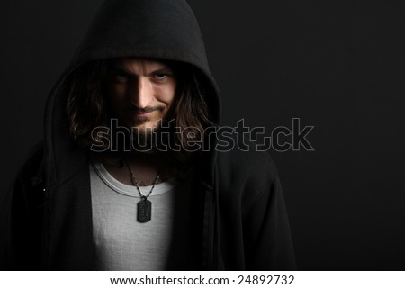 Guy grinning in hood with dogtag