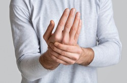 Guy has wrist injury or inflammation of chronic arthritis