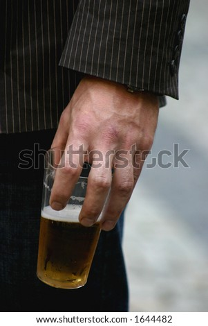 guy holding glass of beer