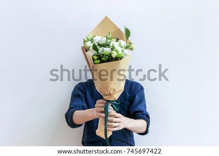 guy holding white flower bouquet