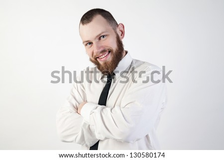 guy in a suit smiles