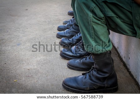 Guy in ARMY GREEN UNIFORM/ / black FIELD BOOTS and BERET /TRAINING, EDUCATIONS AND STAFF DOCUMENTS in Asia /BASIC TRAINING of student /Reserve Officer Training Cops Student / stand behind at the field