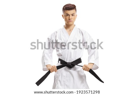 Guy in karate kimono holding his black belt isolated on white background Stock fotó ©