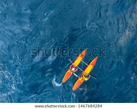 Guy in kayak sails mountain river. Whitewater kayaking, extreme sport rafting. Aerial top view.