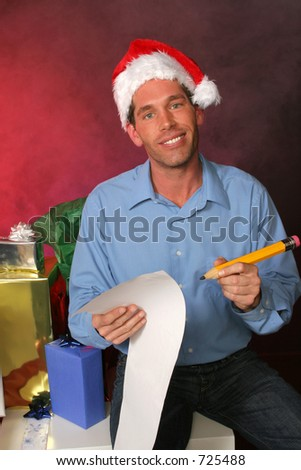 guy in santa hat is double checking his list for the holidays surrounded by gifts in a misty red background
