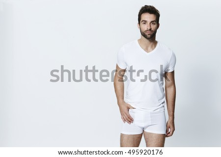 Guy in white underpants, looking at camera