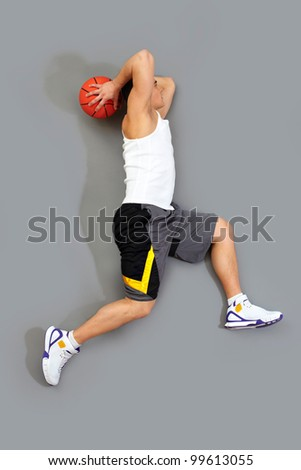 Guy jumping to score a goal playing basketball
