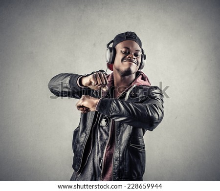 Guy listening to music and dancing