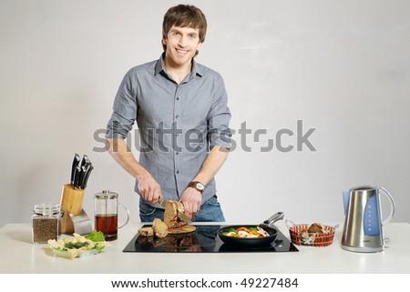 Guy on kitchen